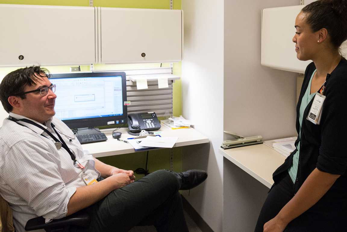 Randal Richardson, MD, talks with his research assistant, Brianna Person.