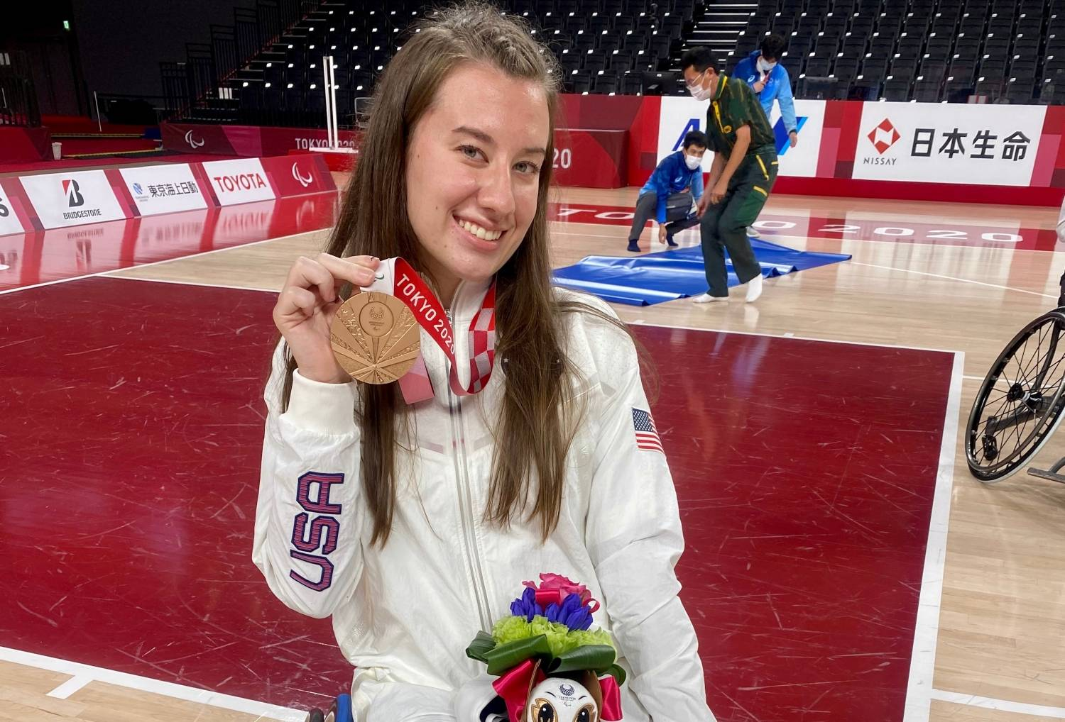 Abby Bauleke, Holding her bronze medal at the Paralympics.