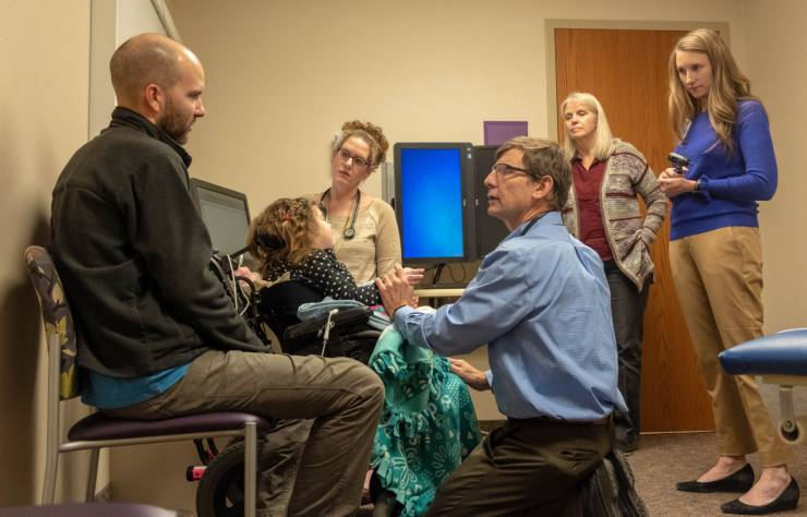 Gillette's Aerodigestive clinic care team members work with patients