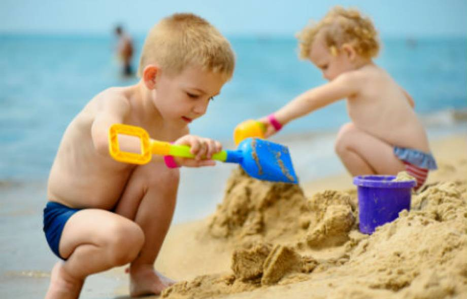 Two little kids playing on the beach