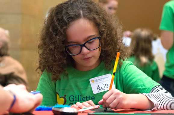 Gillette patient works on artwork project during capitol day