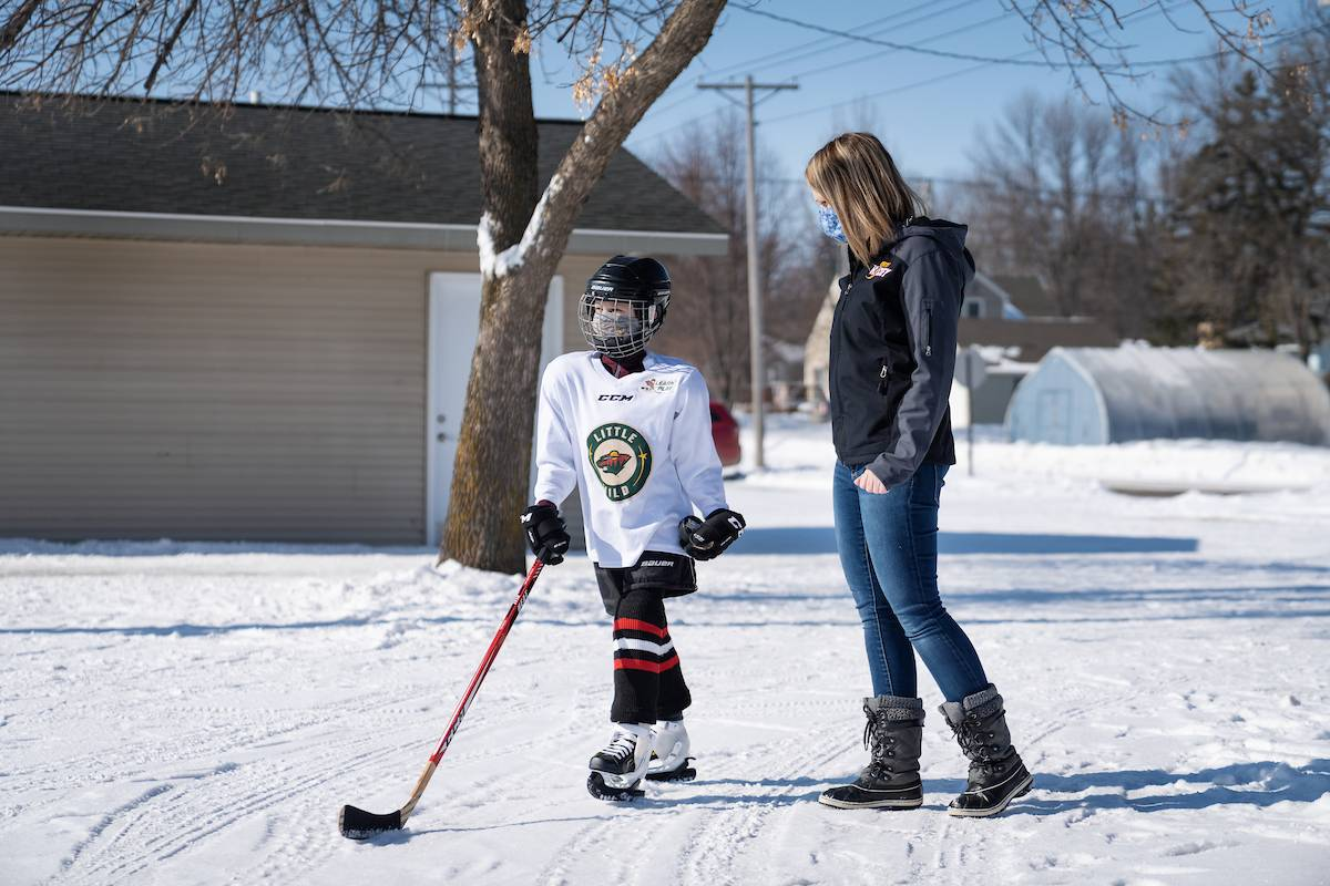 Ethan and his mother walking towards the ice rink