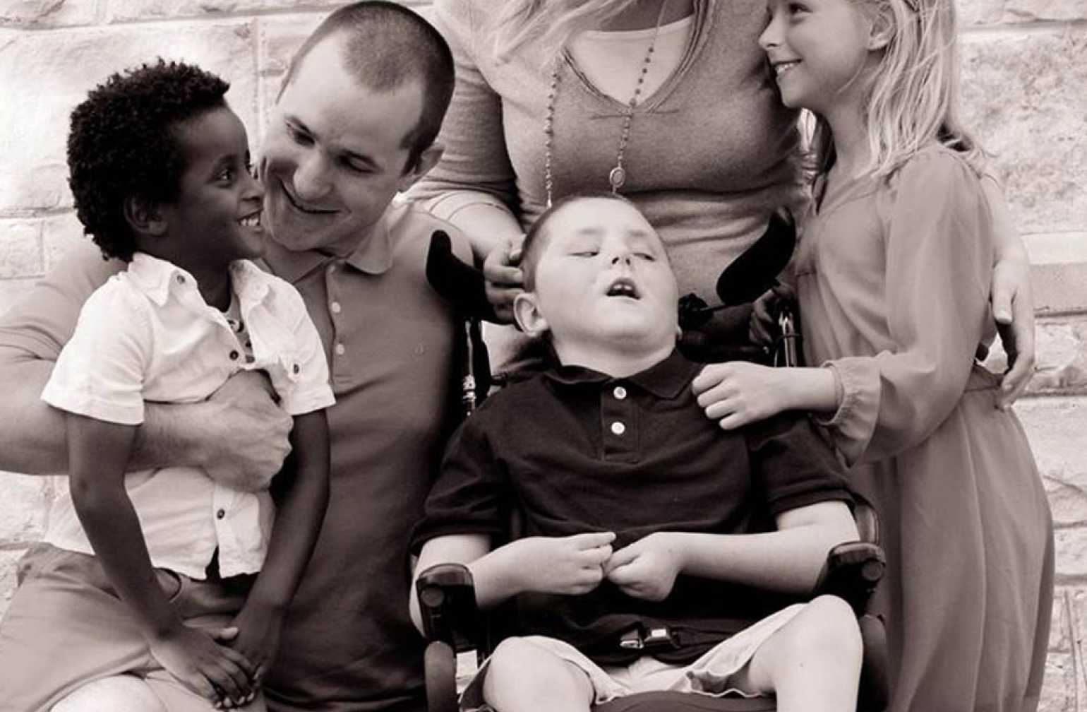 Jeffrey with his family in black and white