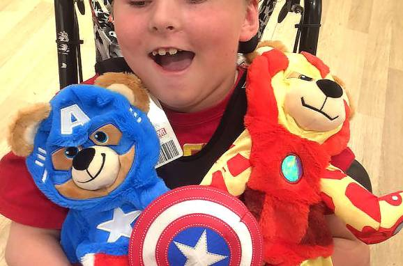 jeffrey holding super hero stuffed animals