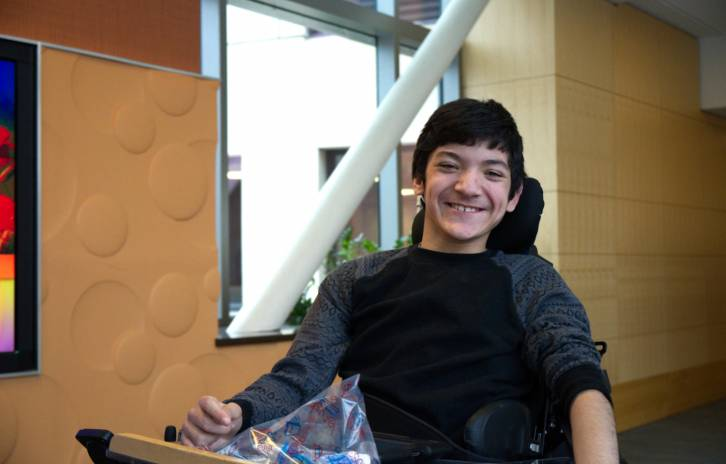 Gillette patient Louie Romero posing in the skyway