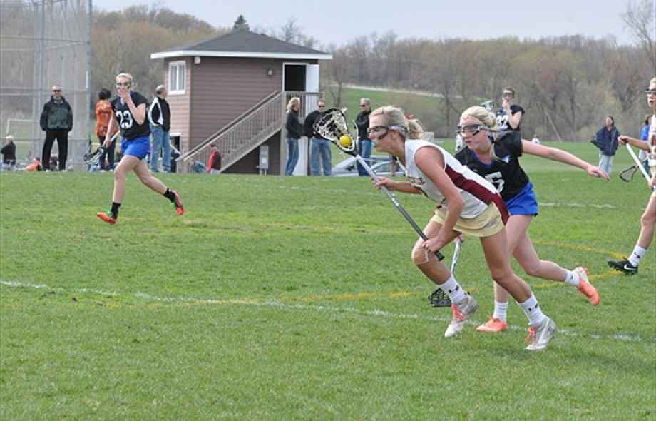 Nicole Doyle playing lacrosse
