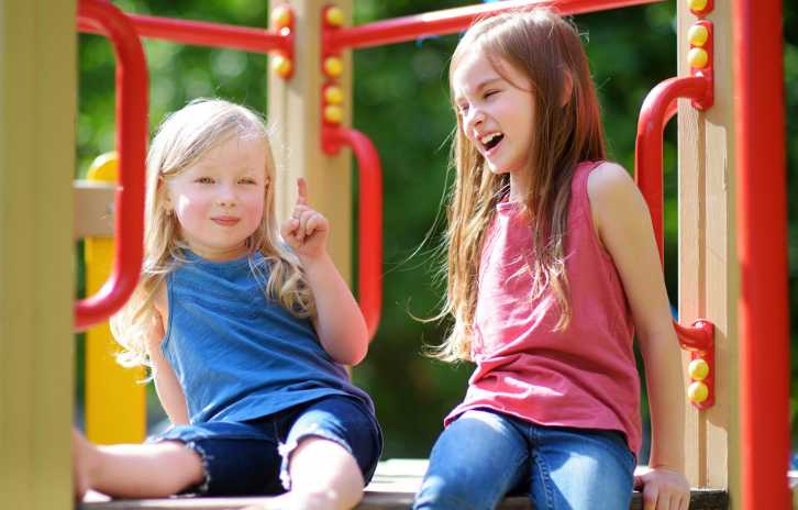 Two little girls on the playground