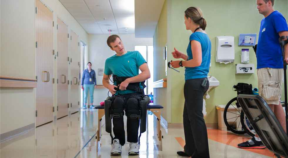 Jackson, Gillette children's spinal cord injury patient during therapy.