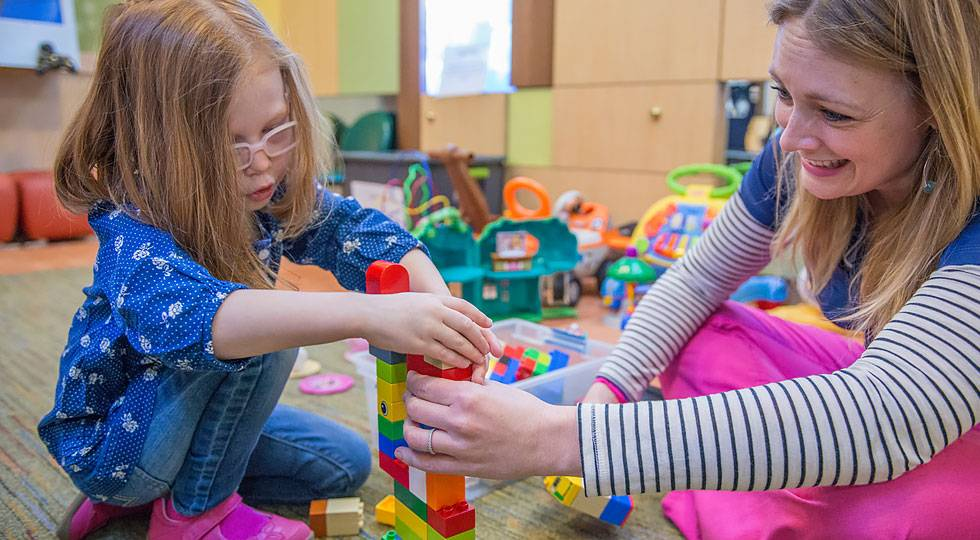 gillette patient ashlyn playing with blocks