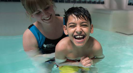 Gillette children's patient Masood during aquatic pool therapy.