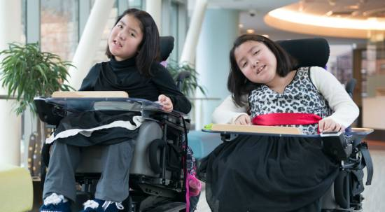 Neuromuscular disease patients kiara and keisy at Gillette children's