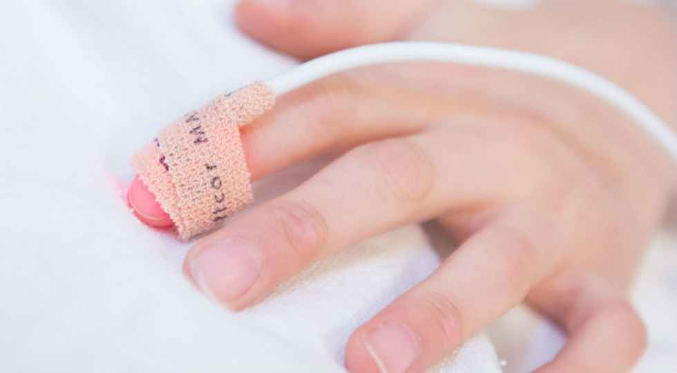 Gillette patient hand during surgery