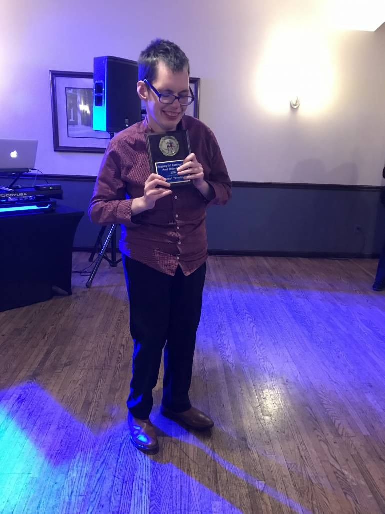 Robert Favorite with an award from stepping out
