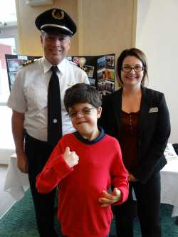 Michael (pictured with Delta Air Lines pilot Darrel Baker and Marriott general manager Erin Maruska).