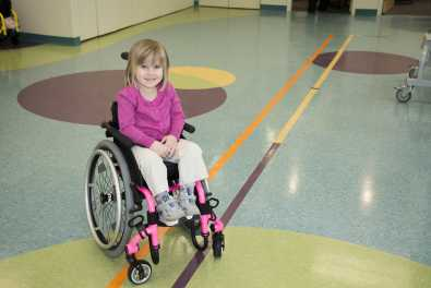 The Berquals know that physical activity is important to Jersey's long-term health. They are looking for a running stroller or adapted bike to help Jersey take part in her dad's training runs.