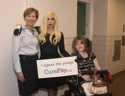 Lady Gage pictured with Gillette CEO Barbara Joers and patient Emma Carroll
