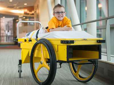 Brock spent time on the Gillette Prone Cart during recovery from rhizotomy surgery.