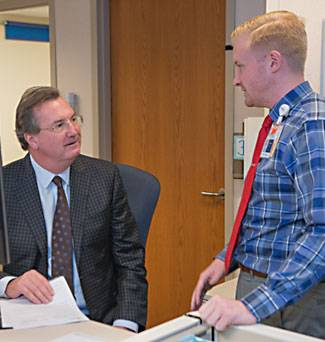 Speech pathologist, Graham Schenck talks to Robert Wood, MD.