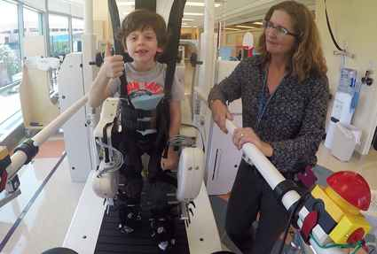 Owen on Lokomat and inpatient rehabilitation nurse at Gillette children's