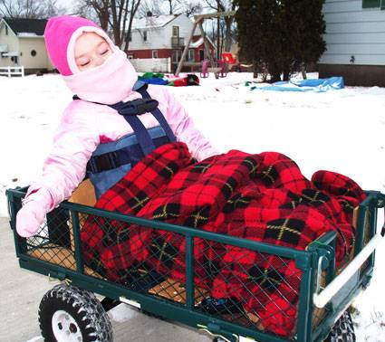 Christina Kademan, who has cerebral palsy, loves wagon rides with her dad, Derek Kademan.