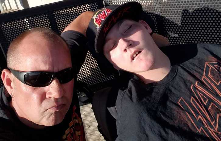 Gillette patient Mason with his dad on mission to see 500 bands.