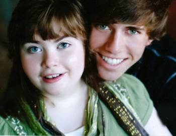 Megan, who has Rett syndrome, is pictured with her brother.