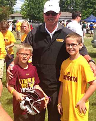 Nick Winge and his brother are pictured with Coach Jerry Kill, who also has epilepsy.