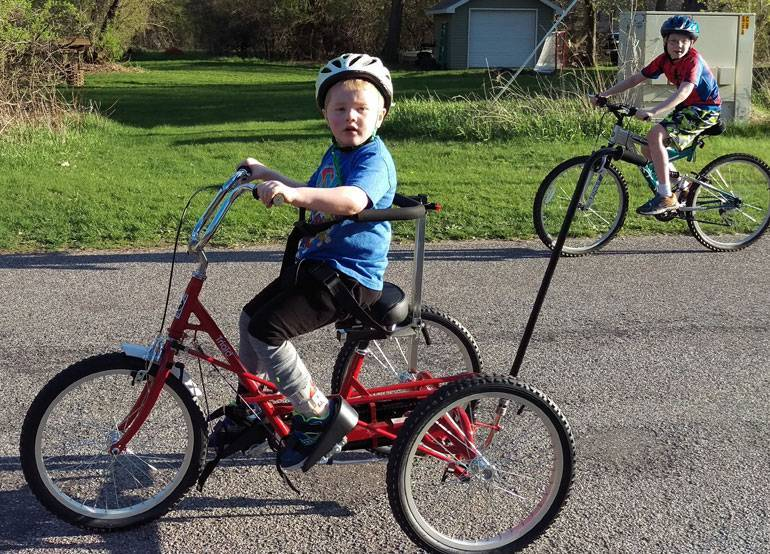 Gavin received an adapted bike from Gillette thanks to the generosity of donors.