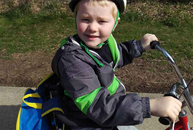 Children like Gavin, who has cerebral palsy, can experience the joy of biking with customized equipment.