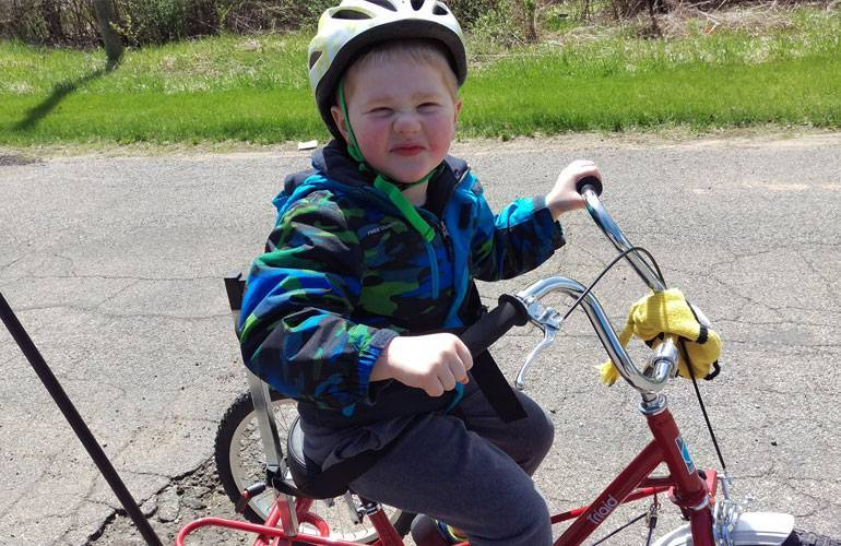 Gavin, who has cerebral palsy, received an adaptive bike thanks to fundraising at Gillette's Pedal in Place event.