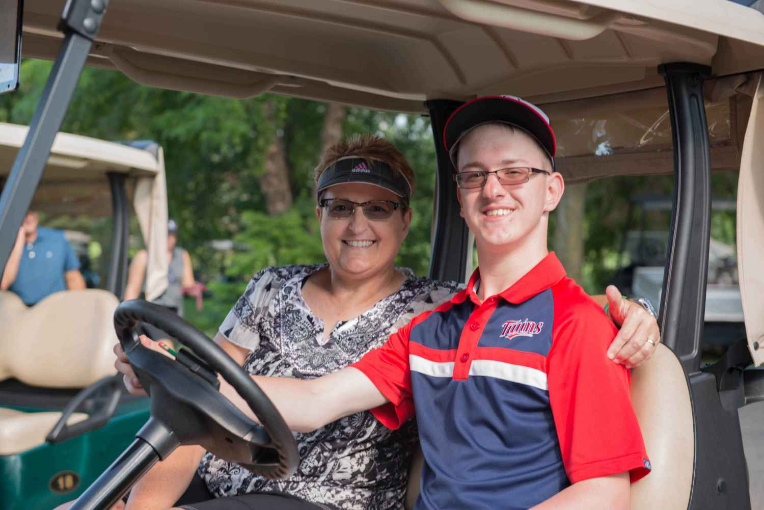 Connor and his mom, Debra, have a fun day at the golf course.