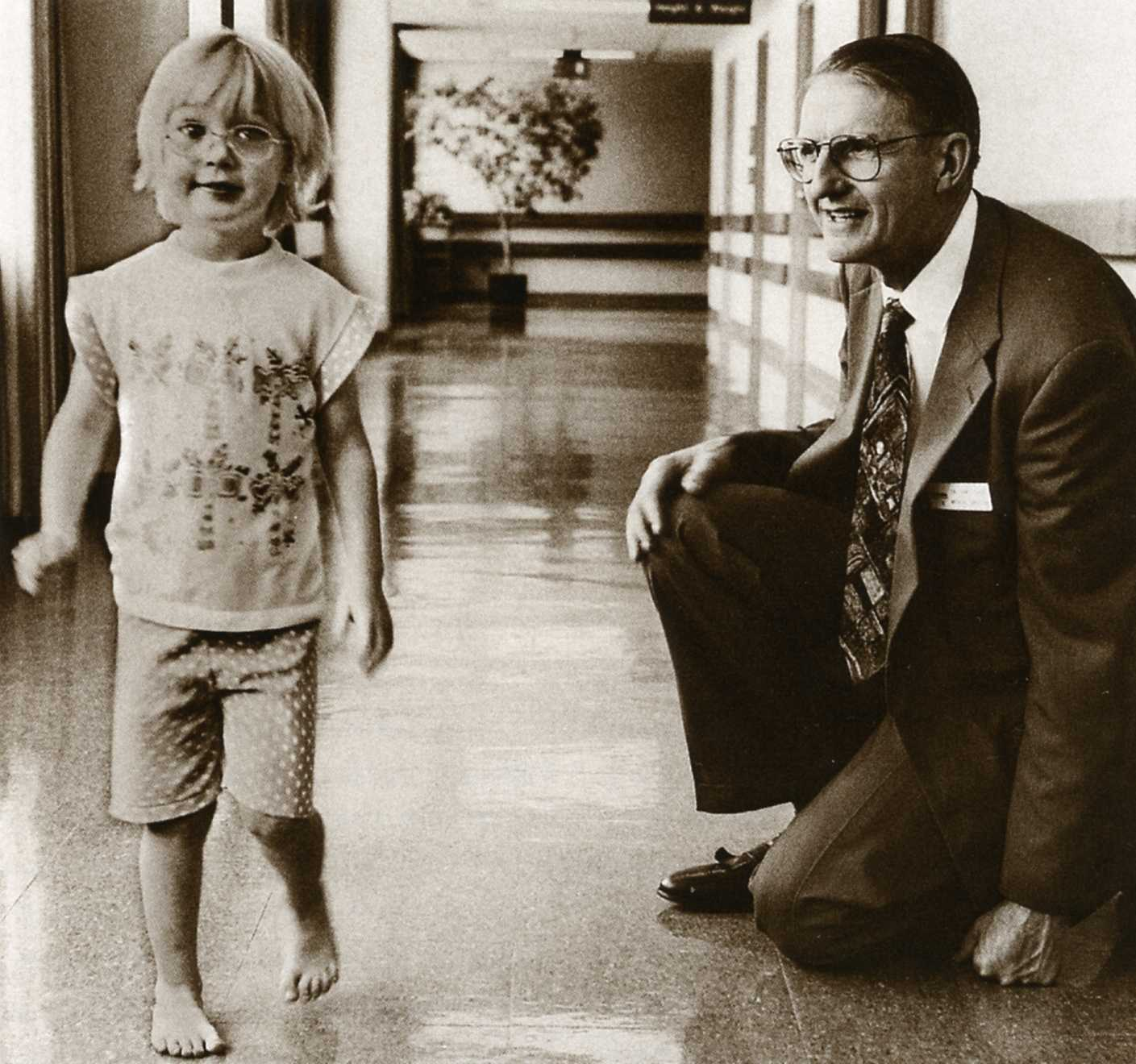 Jim Gage, MD, assesses a young patient's gait.