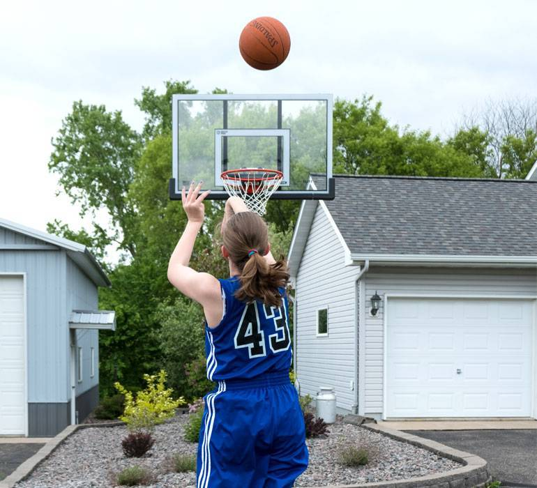 Erika, a skilled basketball player, has scoliosis.