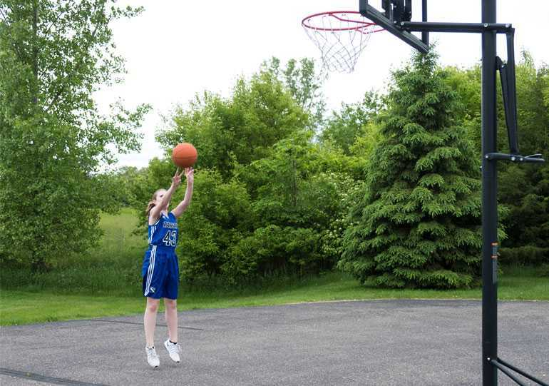 Erika is back to playing basketball after surgery to correct her scoliosis.