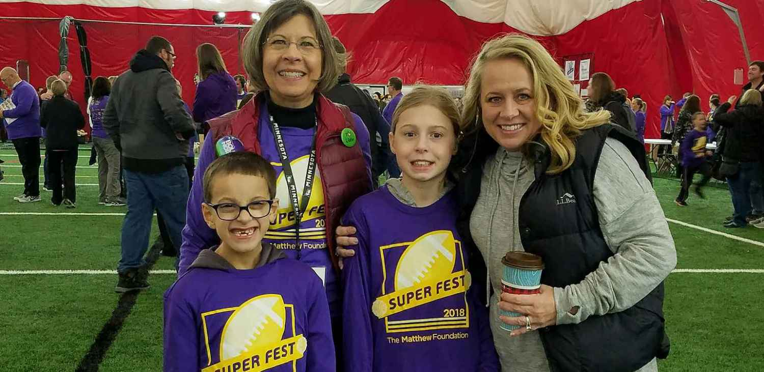 Charlie Brisbine, Dr. Kim McConnell, Charlie's sister Sadie, and his mom, Tricia, enjoyed Super Fest.
