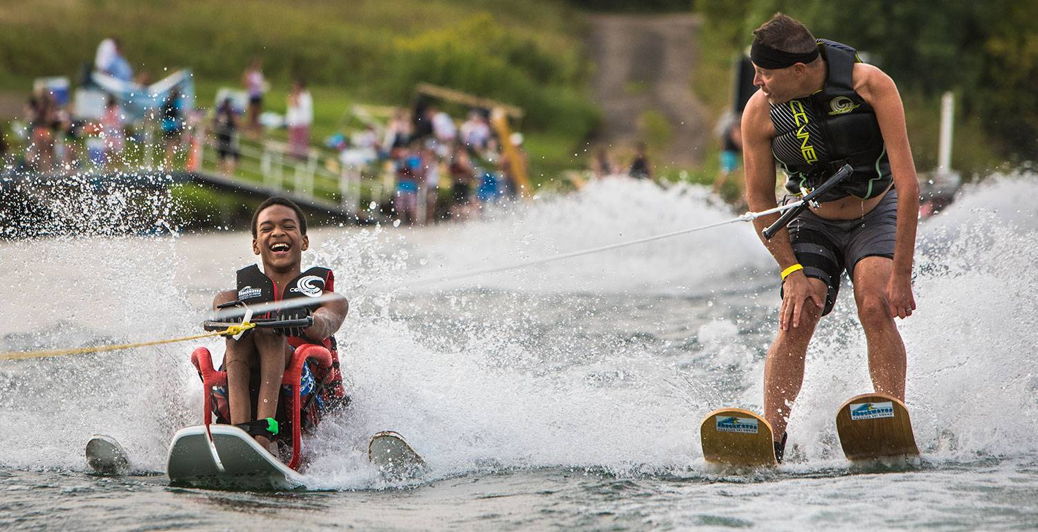 A Gillette patient has fun at an adaptive water ski event.