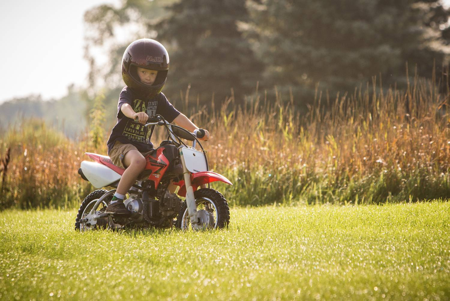 Collin, pictured here, and Simon love playing outside on their dirt bikes.