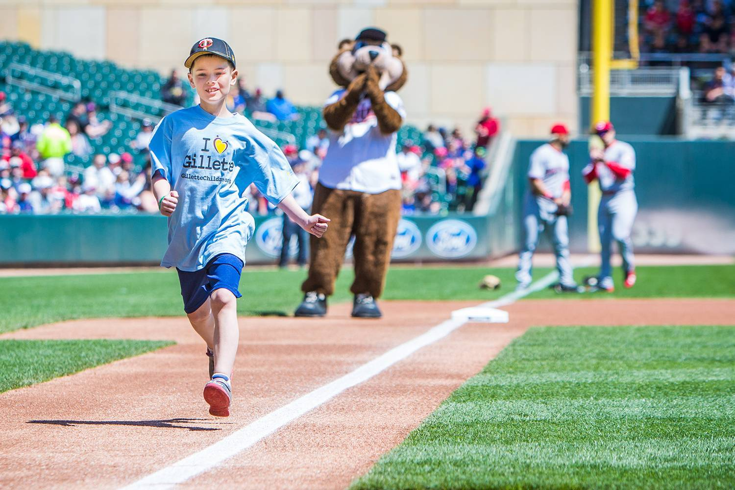 gillette patient Wyatt runs the bases